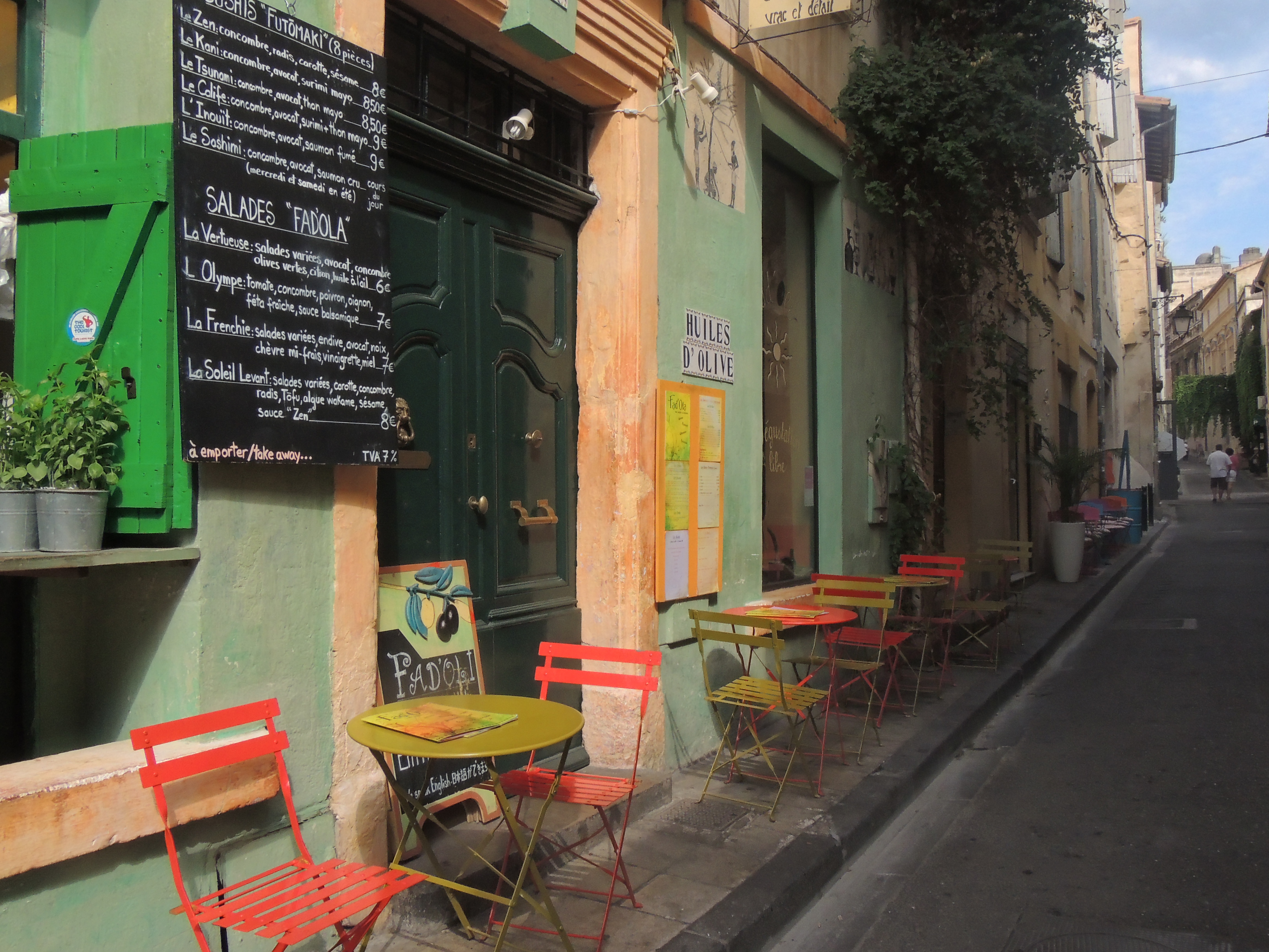 Colourful cafes like this one on the streets of Arles inspired Van Gogh to paint his 'Cafe Terrace at Night'