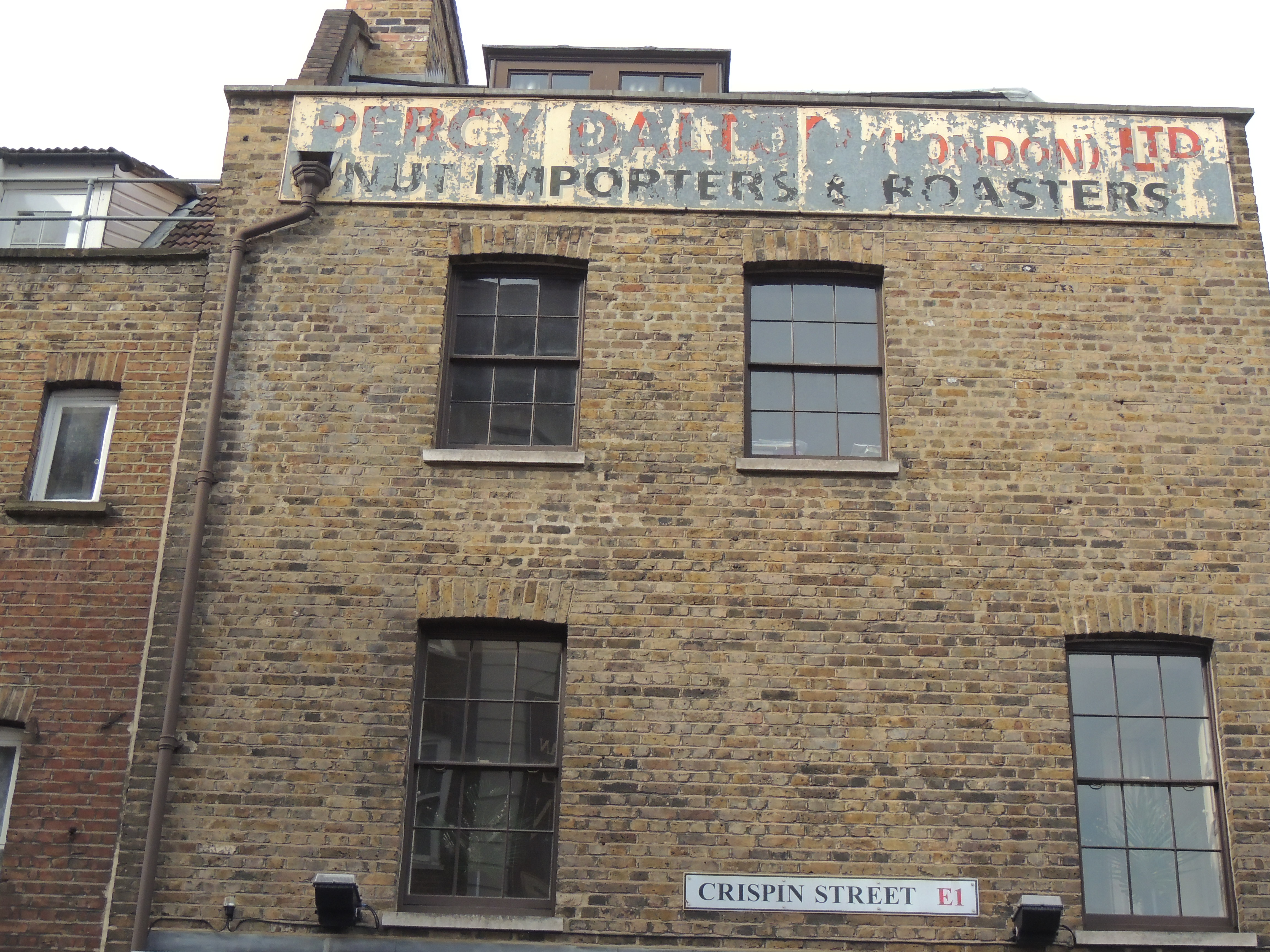 The original advertisement of the nut importers beside the paper bags factory, how convenient!